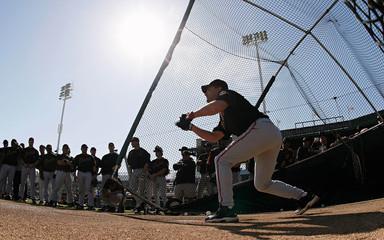 San Francisco Giants Omar Vizquel bunts at the team's practice in Scottsdale
