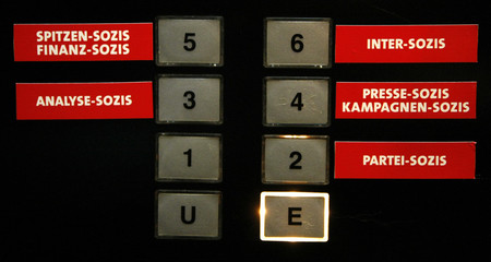 The buttons of an elevator at the headquarters of Germany's Social Democratic Party SPD party are pictured with new signs indicating the different departments in Berlin