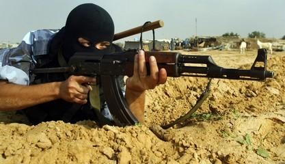 A Palestinian policeman takes position during an operation against smuggle arms in Rafah