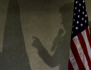 The shadow of US Democratic presidential candidate Hillary Clinton is cast on the wall as she campaigns in Brownsburg