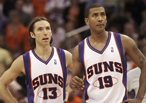 Phoenix Suns' Steve Nash and Raja Bell check scoreboard during game with Los Angeles Clippers in Phoenix
