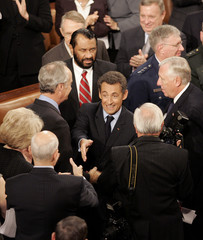French President Nicolas Sarkozy greets members of Congress after speaking in Washington