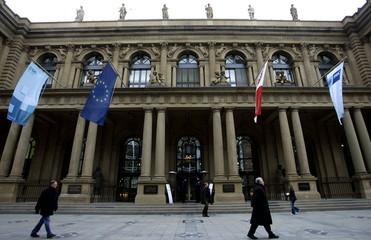 Pedestrians walk by Germany's stock exchange Deutsche Boerse Group in Frankfurt January 14, 2005. Th..