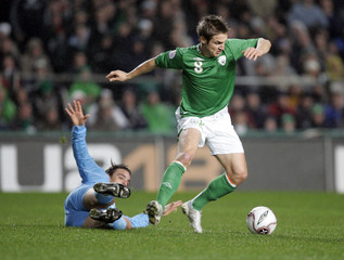 Ireland's Doyle is tackled by San Marino's Simoncini during their Group D Euro 2008 qualifying soccer match in Dublin