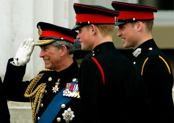 Britain's Prince Charles chats with sons Prince William and Prince Harry after Sovereign's Parade at Royal Military Academy in Sandhurst