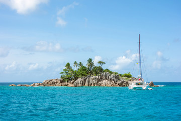 little Island with palm trees with granite rocks in the ocean