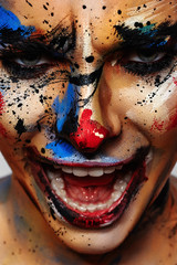 Portrait of laughing insane Clown