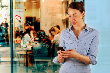 Technology, internet, communication and people concept - happy smiling young woman texting on smartphone