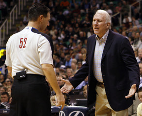 San Antonio Spurs' head coach Popovich argues with game official Fraher during their NBA basketball game against the Utah Jazz in Salt Lake City