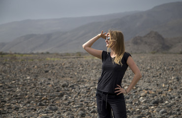 young woman in the landscape of Hajjar Mountains in Oman