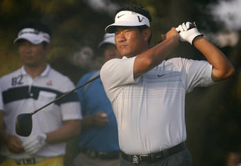 Choi of South Korea tees off on the second hole during practice round for 2009 PGA Championship golf tournament in Chaska
