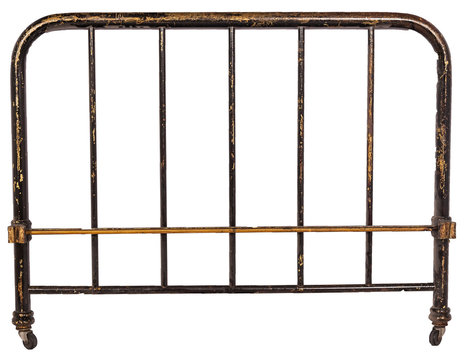 antique brass bed headboard against white background