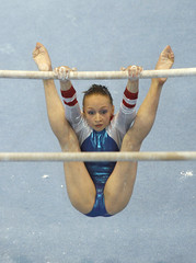 Semenova of Russia performs on the asymmetric bars during women's individual final at the 40th World Artistic Gymnastics Championships in Stuttgart
