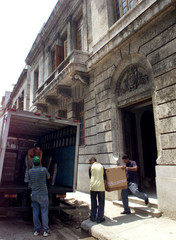 WORKERS CARRY BOXES OUT OF FORMER SPANISH CULTURAL CENTER.