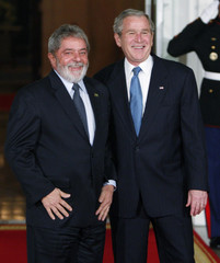 U.S. President Bush greets Brazil's President Lula upon arrival at the North Portico of the White House in Washington