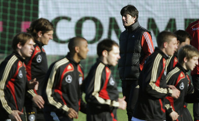 Coach Loew follows warm-up of the players during a training session of the German national soccer team in Berlin