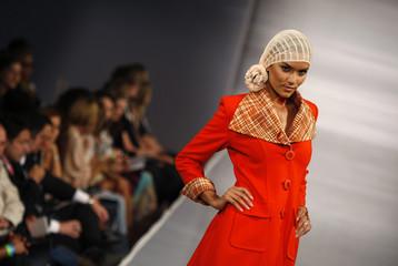 Model displays creation designed by Pili Mirani and Sulma Arizala during Miami Fashion Week in Florida
