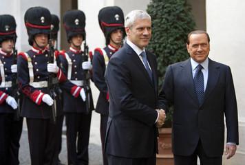 Serbia's President Tadic shakes hand with Italian Prime Minister Berlusconi at Palazzo Chigi in Rome