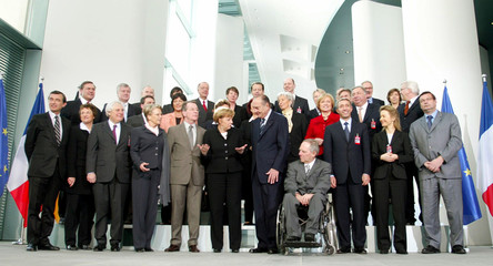 German Chancellor Merkel and French President Chirac pose for a picture with members of the German and French cabinet in Berlin