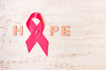 word of hope from a pink ribbon.