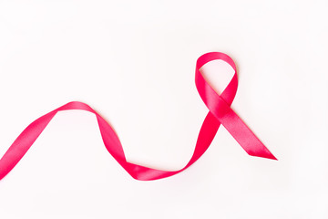 Pink ribbon on white background.