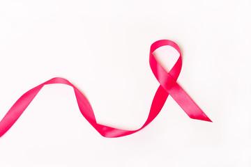 Pink ribbon on white background.