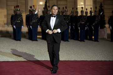 France's Minister of Immigration Besson arrives at a state dinner at the Elysee Palace