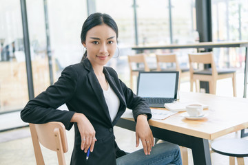 Businesswoman working on desk with laptop computer,Business woman in professional look and happy smiling