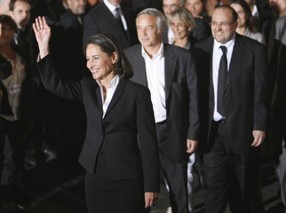 Socialist Party presidential candidate Royal waves to supporters as she leaves a television studio in Boulogne-Billancourt