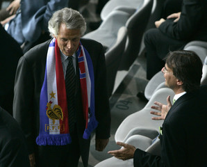 France's Prime Minister Dominique de Villepin waits in the stands before the World Cup 2006 semi-final soccer match between Portugal and France in Munich