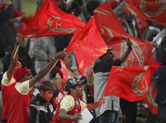 Royal Challengers Bangalore fans wave flags during the 2009 Indian Premier League (IPL) T20 cricket match against Delhi Daredevils in Johannesburg