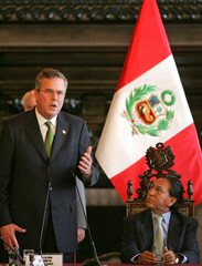Florida's Governor Bush speaks as Peru's President Toledo looks at him in Lima