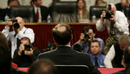Supreme Court Justice nominee Alito takes his chair before the start of his confirmation hearing in Washington