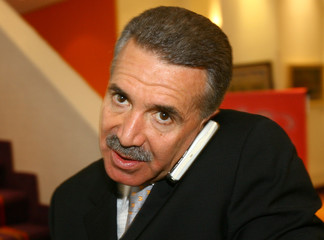 Roberto Madrazo of Mexico's PRI party speaks on a mobile phone in Mexico City