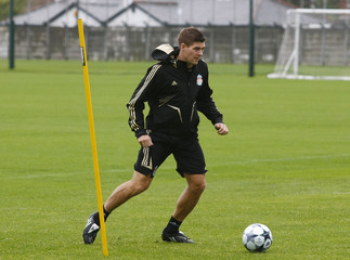 Liverpool's Gerrard runs with the ball during a training session at the club's Melwood training complex in Liverpool
