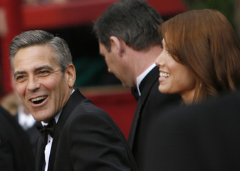 Best actor Oscar nominee Clooney and Sarah Larson arrive at the 80th annual Academy Awards in Hollywood