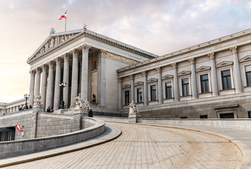 Foto op Canvas Wenen main entrance of Austrian parliament building in Greek style with statues of philosophers and white columns with famous Pallas Athena fountain and in Vienna