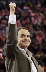 Spain's PM Zapatero gestures during a pre-electoral campaign meeting in Madrid
