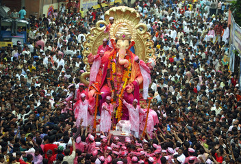 Devotees carry a statue of Ganesh for immersion in the sea in Mumbai