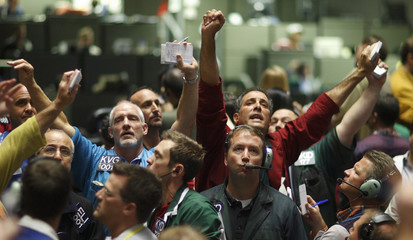 Traders work in the S&P 500 Pit at the Chicago Mercantile Exchange