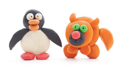 Plasticine cat and penguin.