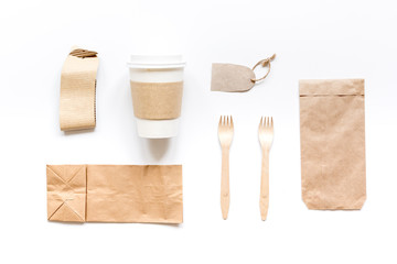 food delivery with paper bags and plastic cup on gray table background top view mockup