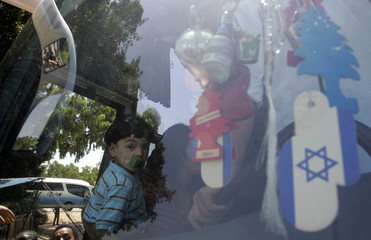 An Israeli child boards a bus evacuating them from the southern Israeli town of Sderot