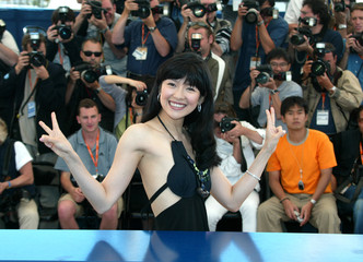 "CHINESE ACTRESS ZHANG ZIYI WAVES FOR ""PURPLE BUTTERFLY"" AT 56THINTERNATIONAL FILM FESTIVAL IN CANNES."