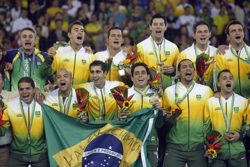 Members of Brazilian National indoor soccer team celebrate after winning the gold medal