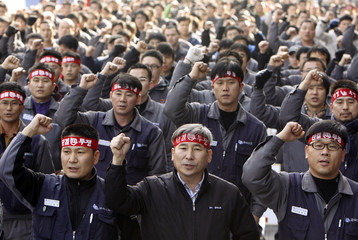 Workers of the Korean Metal Workers' Union chant slogans at a rally against government-led restructuring plans in Seoul
