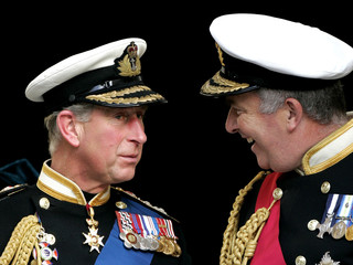 Britain's Prince Charles speaks to Admiral Alan West as they leave St Paul's Cathedral in London