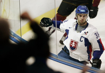 Slovakia's Pavol Demitra celebrates after scoring against Latvia at the Torino 2006 Winter Olympic Games in Turin