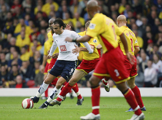 Tottenham Hotspur's Berbatov breaks through Watford defence during their English Premier League soccer match at Vicarage Road