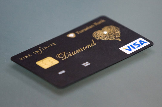 A new VISA card encrusted with diamond and laced with an elaborate gold pattern is displayed in the Eurasian Bank in Almaty